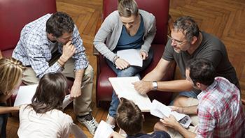 Italian teacher teaching a group of students